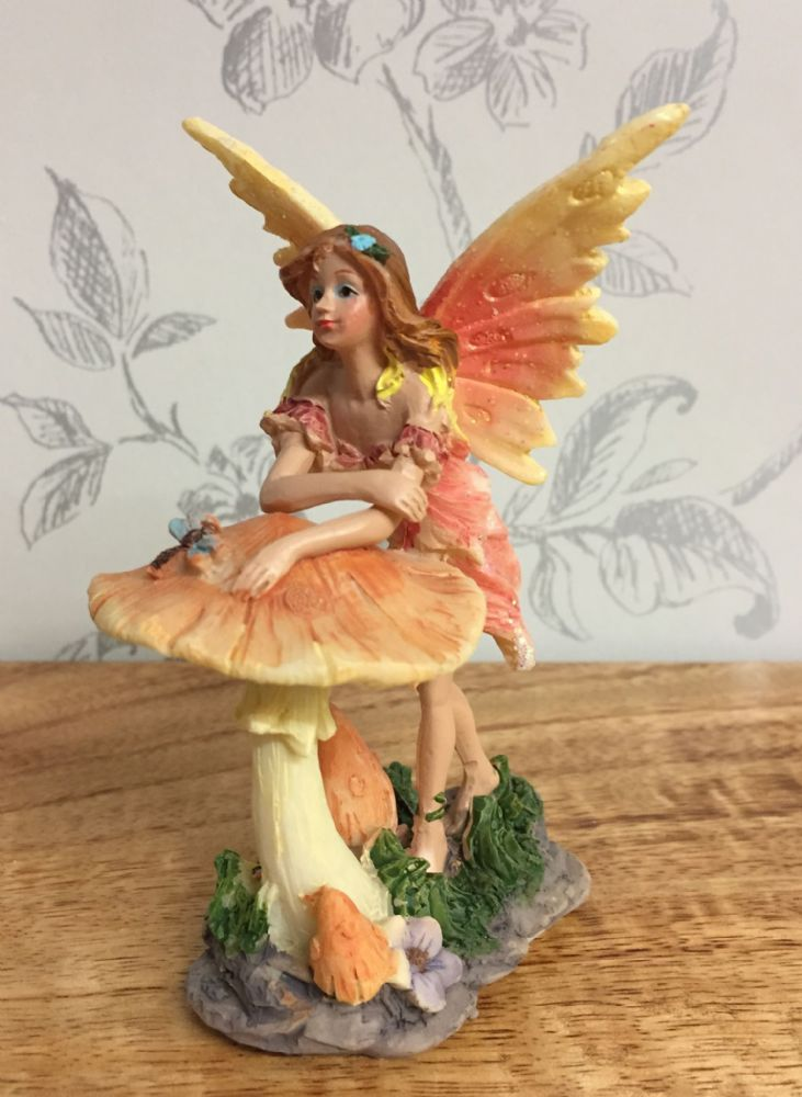 Flower Fairy Figurine Resting on Toadstool ~ Orange Dress